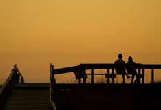 Couple at sunset. A couple watching the sunset together stock photos