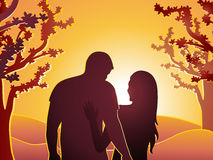 Couple at sunset. Silhouette of couple at sunset with trees Royalty Free Stock Images