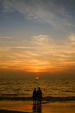 Couple and sunset Stock Image