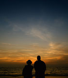 Couple and sunset Stock Photos