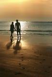 Couple on sunset. Coast of the Indian ocean Stock Photo