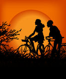 Couple in the sunset. Kind of Urban Art couple in the sunset between black and orange color Royalty Free Stock Photos