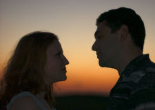 Couple at the sunset. Engagement Portrait Royalty Free Stock Photos
