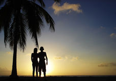 Couple at sunset. A young couple at sunset in the beach Stock Photography