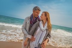 Leisure carefree time. Couple on the sunset beach stock images