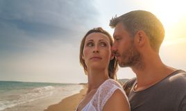 Leisure carefree time. Couple on the sunset beach royalty free stock photo