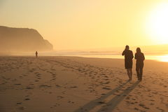 Couple at sunset on the beach Stock Photography