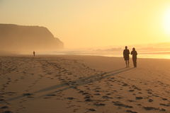 Couple at sunset on the beach Royalty Free Stock Photos