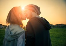 Couple at sunset kissing themselves Royalty Free Stock Photos