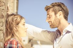 Couple at sunset kissing themselves Royalty Free Stock Image