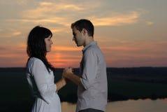 Couple at sunset and lake. Couple sweethearts at sunset and lake Royalty Free Stock Photo