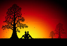 Couple in sunset. Romantic Silhouette Couple in sunset Stock Image