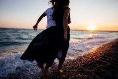Couple at sunset by the sea. stock photo