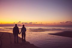 Couple at sunset royalty free stock photos