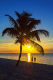 Couple sunset. The silhouette of couple walking at sunset on the beach Royalty Free Stock Images