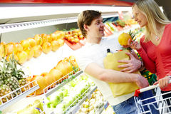 Couple in supermarket Stock Photos