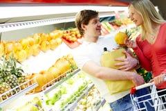 Couple in supermarket stock photos