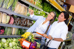 Couple at the supermarket Stock Images