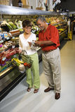 Couple in supermarket. Royalty Free Stock Photo