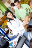 Couple at the supermarket Stock Photos