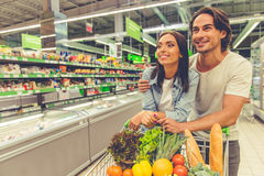 Couple in the supermarket Stock Photos