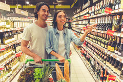 Couple in the supermarket Stock Images