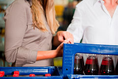 Couple in supermarket buying beverages Royalty Free Stock Image