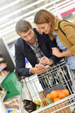 Couple in supermarket buying groceries Royalty Free Stock Photo