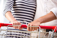 Couple at supermarket hands close-up Royalty Free Stock Photos