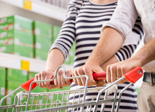 Couple at supermarket hands close-up Stock Image