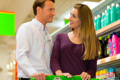 Couple in supermarket with shopping cart Stock Photo