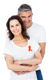 Couple supporting aids awareness together Royalty Free Stock Images