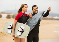 Couple with surf boards on the beach Stock Image