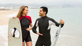 Couple with surf boards on the beach Royalty Free Stock Photo
