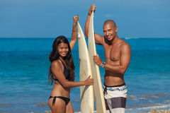 Couple with surfboards Stock Images