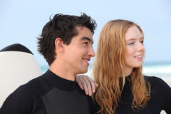 Couple of surfers Royalty Free Stock Photos