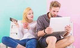 Couple surfing internet posting content social network. Shocking content. Couple content creators work with laptop and royalty free stock image
