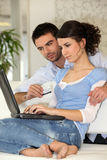 Couple surfing the web Royalty Free Stock Images