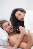 Couple surprised in their bed Stock Photography