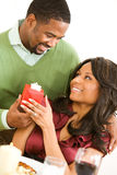 Couple: Surprising Her with a Gift Royalty Free Stock Image