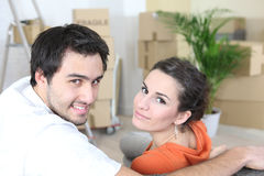 Couple surrounded by packing boxes Stock Image