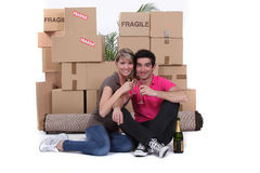 Couple surrounded by their belongings Royalty Free Stock Photo