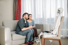 Couple swears at doctor skeleton reception Stock Photo