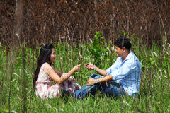 Couple sweet teasing in grassland, national park Royalty Free Stock Images