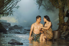 Couple swimming with fun in natural Stock Photo