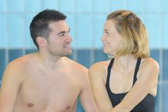 Couple at swimming pool royalty free stock image