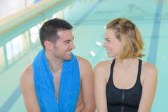 Couple at swimming pool stock image