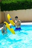 Couple in swimming pool. Couple having fun in swimming pool Stock Photo