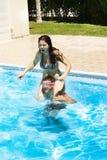 Couple in swimming pool. Couple having fun in swimming pool Stock Images