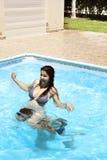 Couple in swimming pool. Couple having fun in swimming pool Stock Photography